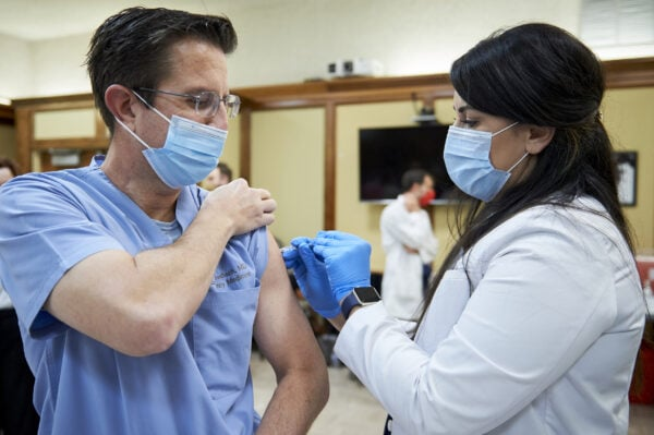 Dr. Kordisch receives the Covid vaccine
