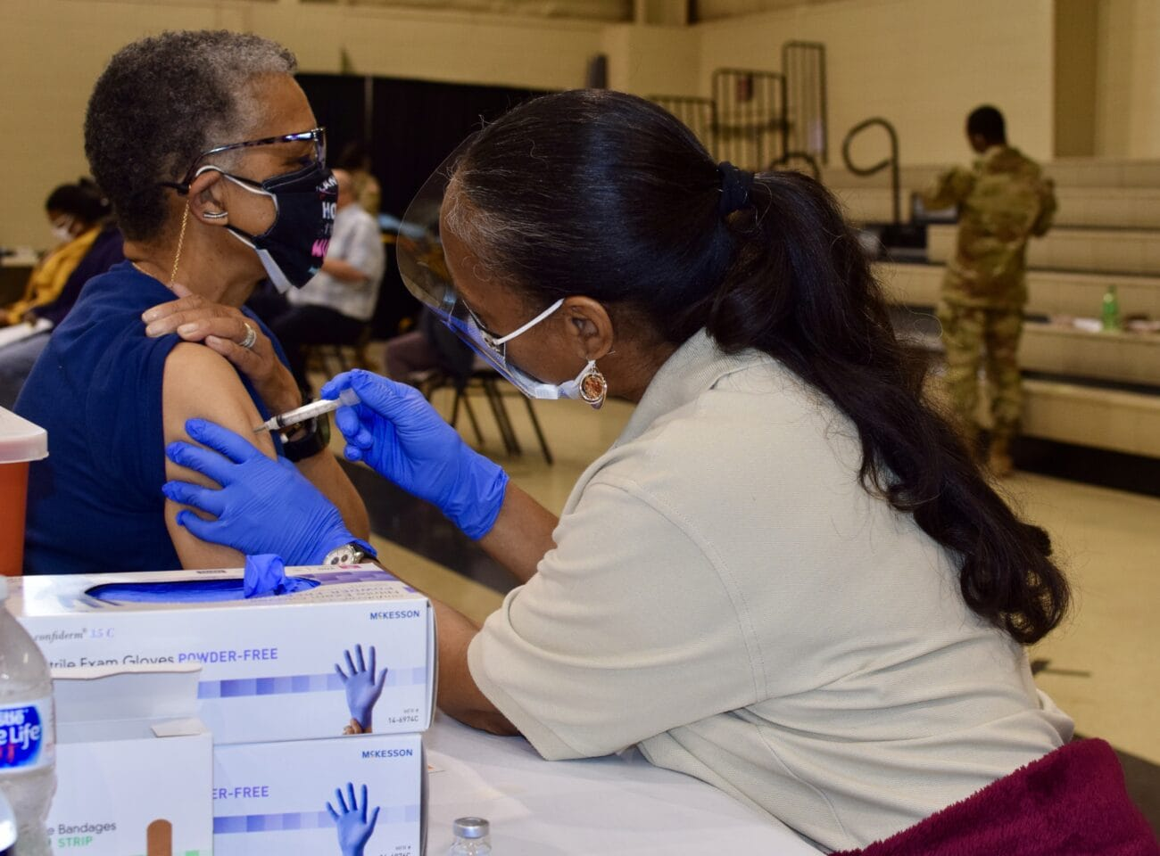 Woman receives first dose of covid vaccine